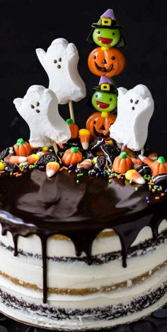 Pumpkin Chocolate Halloween Cake Pumpkin Chocolate Halloween Cake It Will Be The Hit Of The Party Alternating Layers Of Spiced Pumpkin Cake And Moist Chocolate Cake Filled With Silky Vanilla Buttercream And Topped With A Drippy Dark Chocolate Glaze Halloween Torte, Bolo Halloween, Halloween Birthday Cakes, Halloween Desserts, Halloween Treats, Halloween Chocolate Cake, Haunted Halloween, Halloween Dinner, Halloween Parties