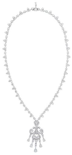 """This, my dears, is a 'Les Danses Fantasques Giselle' diamond necklace by Fabergé. Here's the auction description from Phillips: """"Designed as a scrolling plaque set with pear and circular-cut diamonds suspending five fringes of pear and circular-cut diamonds, to the diamond link back chain, mounted in platinum, chain length 18 ¾ inches, pendant length 2 ¼ inches."""""""