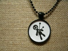 Voodoo Doll Necklace by UnearthlyTreasures on Etsy, $10.00