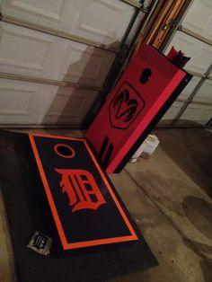 "Blue & orange Detroit Tigers boards beside the Red & Black Dodge SRT Cornhole Boards my Business ""CornStar creations"" made!!"