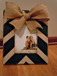 Chevron Burlap Bow Frame - Wood frame   painted black and cream chevron stripes. The edges are sanded down for a   distressed look. Burlap bow added for that cute country cottage   look!