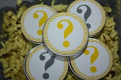 Question marks on mini tins filled with a certain color candy!