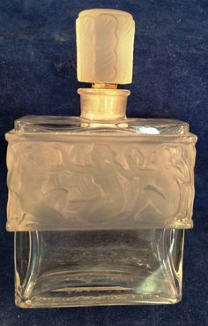Molinard de Molinard Creation Lalique Perfume bottle  This lovely bottle is not made by Lalique but by Henri Pochet also know for their high quality glass.   It is modeled from a R. Lalique design with a row of nudes around the bottle.