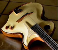 Stardust - a hollow body, slimline jazz guitar made from fine Italian spruce, sapele mahogany and ebony tonewoods - designed and fully handmade/handcarved by Murray Kuun in Jozi