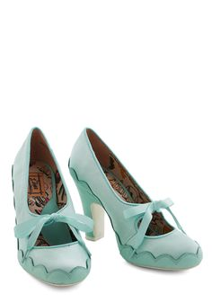 Trim and Proper Heel, #ModCloth-- You love mixing retro, feminine style with a dash of whimsy, so these mint Mary Jane heels by Miss L Fire were destined for your wardrobe!  A charming example, these silky pumps are trimmed in scalloped leather for subtly striking contrast. Topped by a dainty ribbon closure, these swoon-worthy shoes are the perfect match to your lace frock!