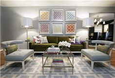 Art Array. Groupings of similar prints are eye-catching in a symmetrical array. This arrangement provides an excellent focal point  for a large wall, and the geometric positioning lends a formal feel to the room.  Designer: Beth Dotolo & Carolina Gentry