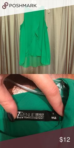 New York and company sleeveless blouse Very gently used, worn once. Shirt is a beautiful green, sleeveless and falls just below waist. New York & Company Tops Blouses