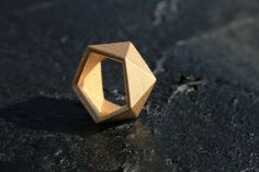 Made from a hybrid of modern production techniques with traditional casting methods, this ring is stainless steel/gold plated, 3D printed and designed by our Brooklyn based jewelery/industrial designers.