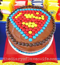 Super hero chocolate cake with design made from M&Ms