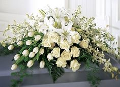 this was at Momma's service...white tulips, white roses, white lillies, white orchids.....