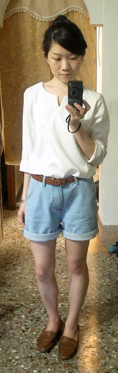 v-neck white shirt + denim shorts + belt + moccasins + bun, maybe a bucket hat as well.
