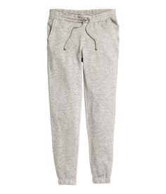 Black. Sweatpants with ultra-slim legs, elasticized drawstring waistband, and side pockets. Elastication at hems. Brushed inside.