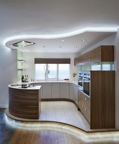 Contemporary Kitchen Design With Curve Wooden Kitchen Cabinet and White Countert. - Home Decor Design Contemporary Kitchen Design With Curve Wooden Kitchen Cabinet and White Countert. Wooden Kitchen Cabinets, Kitchen Cupboard Designs, Kitchen Cupboard Doors, Best Kitchen Designs, White Cabinets, Luxury Kitchen Design, Contemporary Kitchen Design, Luxury Kitchens, Interior Design Kitchen