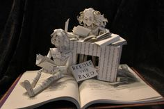 """Hermione and Harry Book Sculpture by WetCanvasArt on Etsy  --  Just like the muggle world, the world of magic has their own fairy tales. The stories of Beetle the Bard are referenced many times in the Harry Potter series, but did you know that Hermione translated them? This book sculpture shows Hermione hard at work, with a little help from Harry.   Sculpture is made from """"The Tales of Beetle the Bard"""" by J.K. Rowling."""