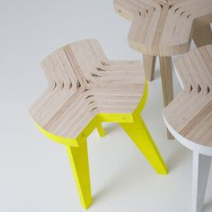 Called Offset, the seat is made of slices cut from one piece of bent plywood attached to three leg profiles by metal bars.