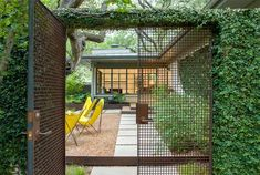 Private courtyard - fedge / fence covered in vines - wire mesh gate - pea gravel - Bridle Path Residence - Ten Eyck Architecture Design, Landscape Architecture, Landscape Design, Garden Design, Architecture Drawings, Outdoor Spaces, Outdoor Living, Grades, Pergola