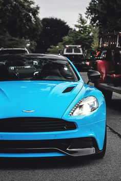 Turquoise blue Aston Martin Vanquish. I am very fond of that color. I'll take it. Sold.