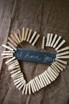 Cute clothes pin wreath. Made with a white coat hanger molded into a heart, attach clothes pins around the wire. I am going to paint mine red and pink alternating the colors.