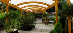 Timber walkways guide customers around external retail sales area at Ashtead Garden Centre Canopy, Pergola, Garden Centre, Outdoor Structures, Walkways, Greenhouses, Building, Retail, Display