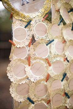 gilded doily escort cards // photo by JessBarfield.com  WAHOOOOO! The big day is on Pinterest from ruffled blog