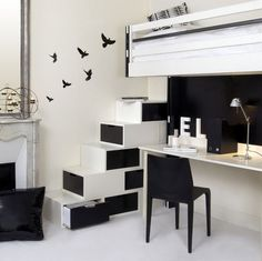 I like this home office because it looks very modern and sleek. its black and white color scheme makes it very clean and uncluttered looking.
