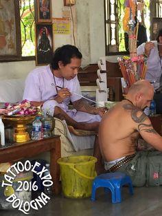 A Thai tattoo artist at work