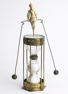 Hourglass with tight rope walker 16th century, France, artist unknown. Besançon ; Time Museum