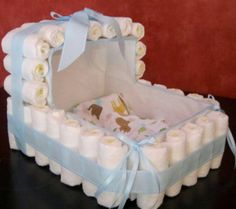 Are you looking for a unique gift for a baby shower. I make all types of diaper cakes custom made to order. Bring one of these amazing hand made gifts that everyone is sure to talk about. All items are connected so they can be taken apart and safely able to be used on the little bundle of joy