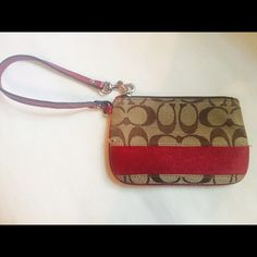 Coach Wristlet Gorgeous red detail Coach wristlet. In great shape. My favorite Cruise accessory! One minor tear shown in last picture and a little wear on strap. Strap is removeable Coach Bags Clutches & Wristlets