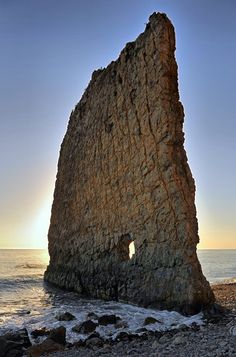 Sail Rock, also known as Parus Rock, is a natural sandstone monolith located on the shore of the Black Sea, in Krasnodar Krai, Russia, about 17 km from the resort city of Gelendzhik.