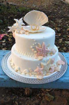 Delightful two tier coral beach wedding cake.