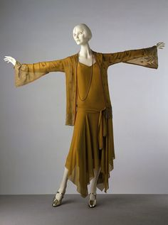 The flattering handkerchief hemline was cut on the bias and innovated by Madeline Vionnet in the early 20th century.