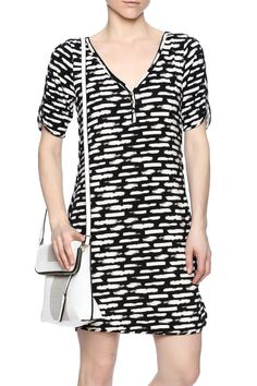 Black and white knee length dress. This dress is a v-neck with three silver toned buttons elbow sleeves with slits and tasteful slits on sides of dress as well.  Short Sleeved Dress by Tart Clothing. Clothing - Dresses - Printed Clothing - Dresses - Short Sleeve California