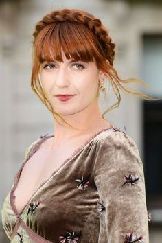 Florence Welch stole music and fashion hearts alike with her stunning voice and striking crimson hair.
