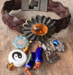 Bohemian Brown Leather bracelet with Yin-Yang bead, Hand of Fatima and Buddha charm - YIN YANG FLOWER - Bohemian jewelry & African jewelry   by DazzlingDivaJewels, $49.00  Designed & Created by Patrice
