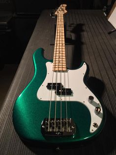 An in Emerald Green Metallic, white guard, maple neck with Clear Satin finish. Manchester United Legends, Bass Guitars, Satin Finish, Emerald Green, Drums, Grunge, Music Instruments, Metallic, The Unit