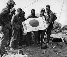 US Marines pose with the Japanese flag, after capturing the island of Iwo Juma. ( C Joseph Schwartz/CORBIS.) Photos From the Battle of Iwo Jima to Mark Its 70th Anniversary | History | Smithsonian.