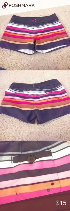 The North Face Multicolored Shorts Nice shorts from the North face. Black with gray white pink orange purple and brown stripes. Two snap closure with velrco closure. One pocket on the back. Some minor color fading the black. Pictures attached. Still tons of life left The North Face Shorts