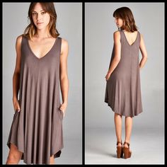 COMING SOON!! Cafe LOOSE FIT DRESS WITH POCKETS Sizes S, M, L. Photos used with vendor permission. Southern Charm Boutique Dresses Asymmetrical
