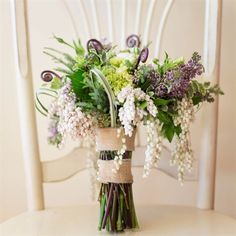 Textured Purple Bridal Bouquet -  textured blooms including lilacs and fiddlehead ferns.