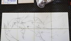Work in progress. The drawing is transfered to the tiles using charcoal powder trough small holes on the transfer paper.  Question: - Should I paint the koi fishes in blue tones -  Or should I paint them coloured?