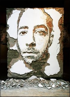Portuguese artist, Alexandre Farto aka Vhils takes street art to a deeper level with his deconstructed street portraits. He creates striking multi-textural faces in decaying brick walls by meticulously chipping away at the wall's weathered layers. Vhils brilliant work ranges from paper, wood, metal and billboards and can be seen in galleries and streets around the world.