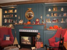 Colonial Living / Palmer fireplace with built in shelves and beadboard cupboards.