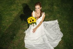 Our beautiful bride holding her sunflower bouquet.