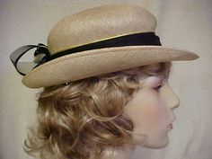 Beige linen look straw hat with black band and back by designer2, $24.00