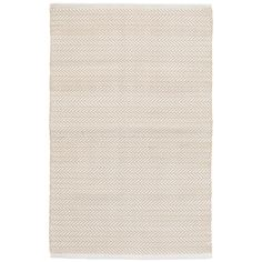 Take neutral spaces to the next level with this ultradurable indoor/outdoor rug, featuring a subtle herringbone pattern in a soft beige and white combo.