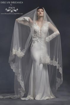 Beautiful hand-detailed lace appliqué veil - Veil measures measures 9.8 feet long (3 meters). - Color: Off White (ivory) Production time: 3-6 weeks
