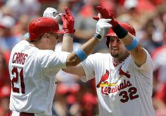 Matt Adams is congratulated by teammate Allen Craig after hitting a two-run home run during the second inning of a game against the Nationals. Cards won 5-2. 6-15-14