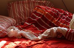 messy bed in red stripes