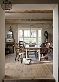 FARMHOUSE – INTERIOR – vintage early american farmhouse showcases raised panel walls, barn wood floor, exposed beamed ceiling, and a simple style for moulding and trim, like in this farmhouse, new life at white cross farm.